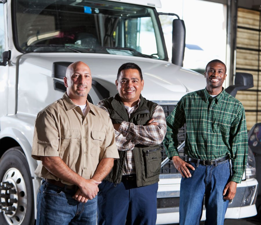 3 happy truck drivers