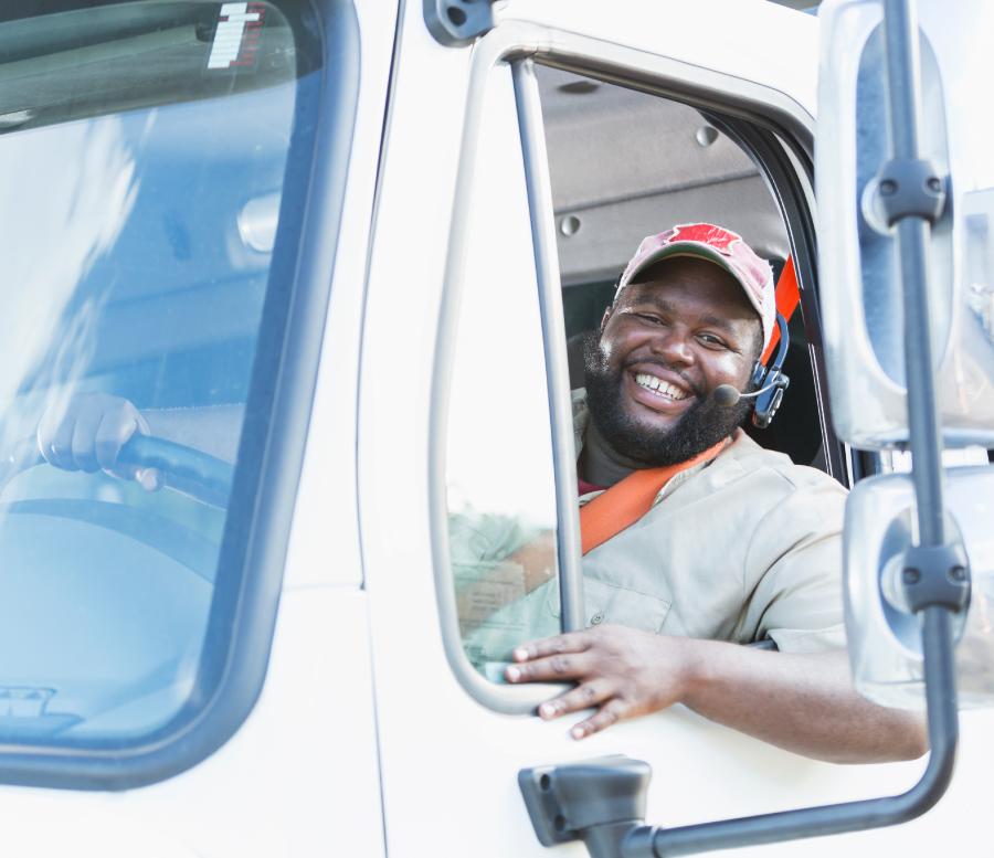 Happy truck driver hauling a load